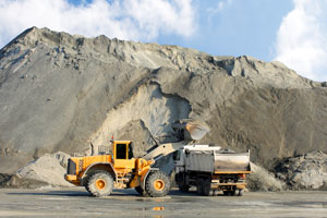 Excavator and truck in mine